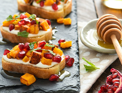 Butternut Squash and Pomegranate Crostini with Whipped Feta and Honey